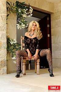 Tommie Jo in black bodysuit and animal print stockings