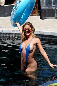 Cherie Deville shows off smoking hot milf body in sheer blue sling bikini