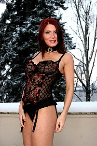 Bettie Ballhaus in black lingerie getting naked in the snow