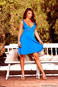 Charlie in a blue dress strips down outdoors
