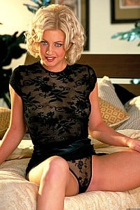 Andrea Trinity raises up her tight black miniskirt