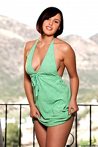 Brooke Lee Adams bursts out of her green dress