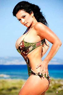 Denise Milani in camouflage beachware on beach