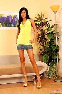 Zoe Montada in yellow top and jean skirt