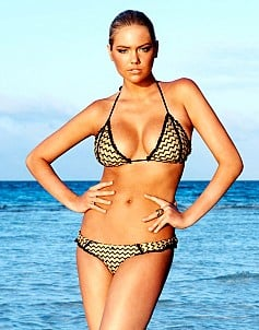 Kate Upton posing in bikini on the beach