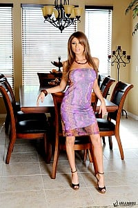 Lisa A Daniels stripping purple dress in dining room