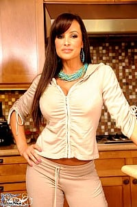 Lisa Ann strips off her sweat pants and sexy lingerie in the kitchen