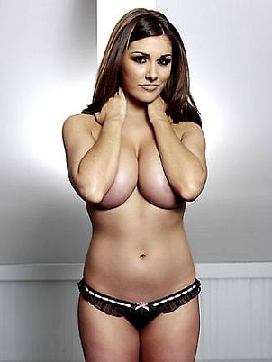 Lucy Pinder posing topless in tiny thong