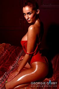 Georgie Darby in red lingerie on bed wet and naked