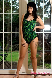 Mellisa Clarke sliding off green one piece outfit