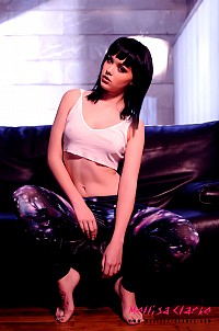 Mellisa Clarke strips from her white top and tight galaxy print pants