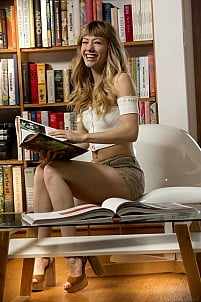 Hot and provocative Ivy Wolfe gets nude in library baring her peachy