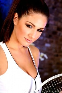 Lucy Pinder in white tennis outfit teasing you by covering her breasts