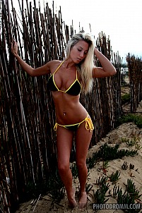 Janine stripping black and yellow bikini at the beach