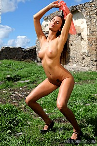 Juliette posing naked by castle ruins
