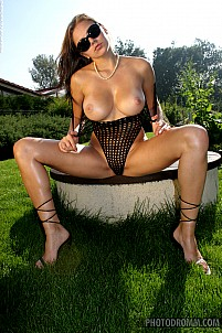 Katka stripping fishnet in beautiful garden