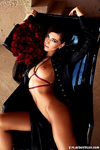 Brittny Ward slides off her leather jacket