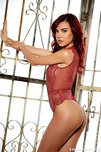 Redhead Sabina Rouge in hot red see-through lingerie
