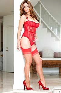 Carrie Stevens posing in red lingerie and stockings