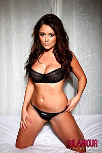 Caitlin Boxwell in black lingerie getting topless on bed