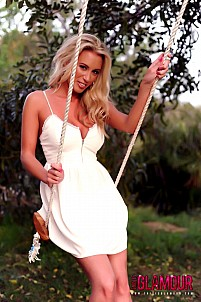 Janine L in white dress on the swing