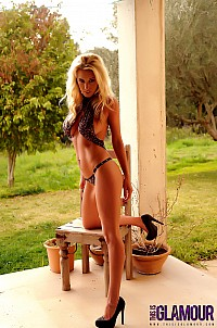 Janine Leech teasing on the patio in her leopard print one piece