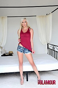 Natalie Fox slips out of her red top and denim shorts
