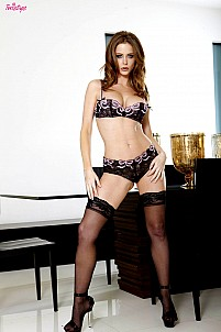 Emily Addison is tempting in her lacy black lingerie