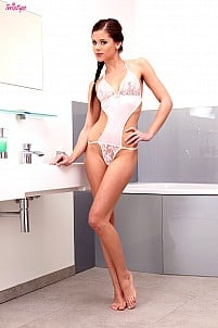 Caprice in one-piece white see-through lingerie in bathroom