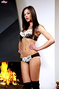 Caprice sliding off sexy black and white lingerie by fireplace