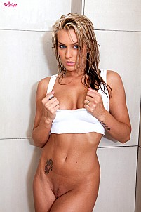 Natasha Marley in the shower only wearing white top