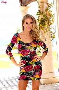 Nicole Aniston in colorful flower dress on the patio