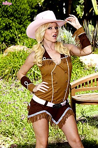 Niki Young as sexy cowgirl getting naked outdoor