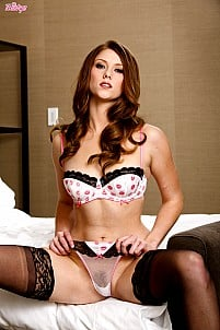 Shae Snow in hot lingerie and stockings on bed