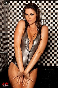 Adrienne Manning in silver bodysuit in the shower