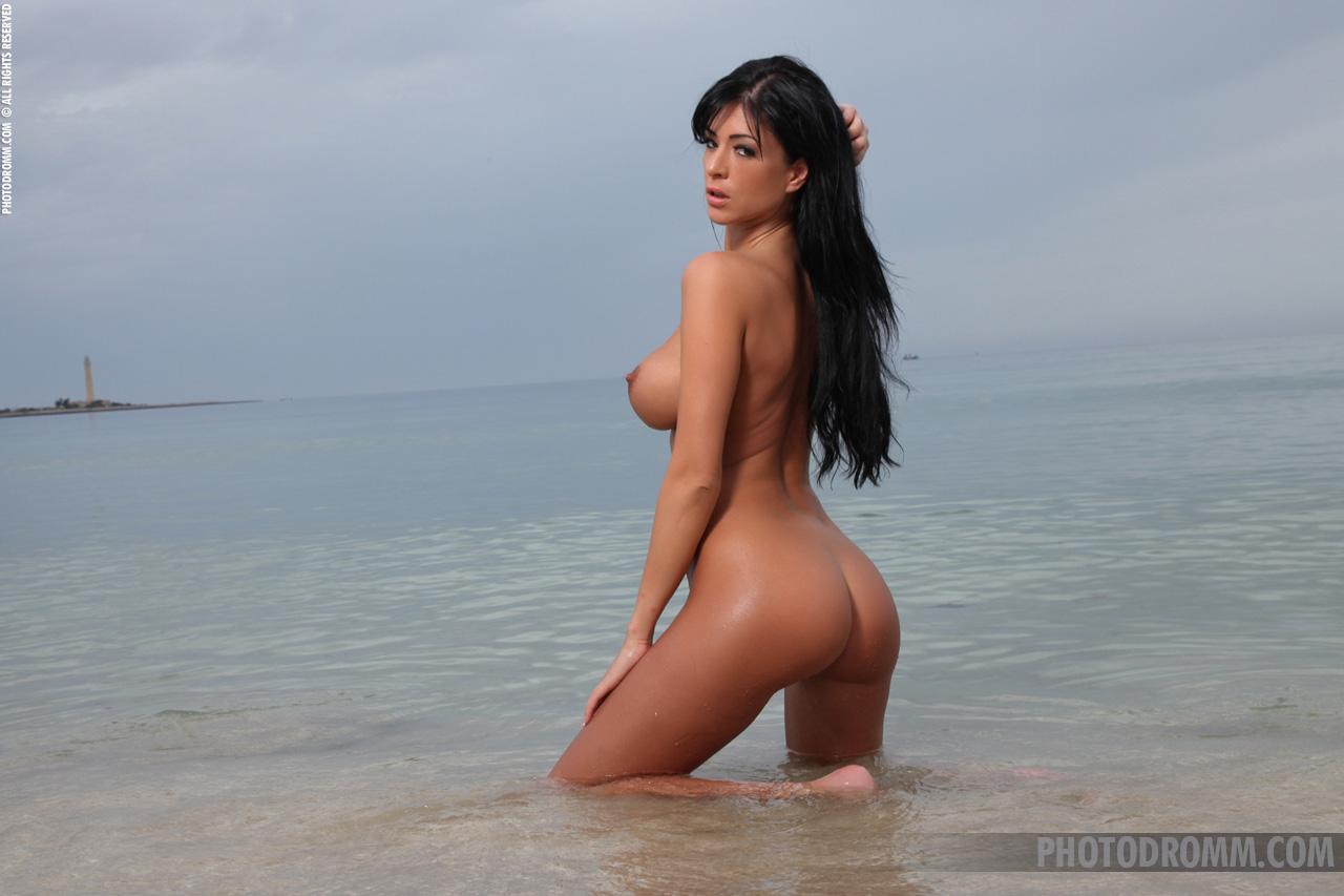 Black girl taking off bikini