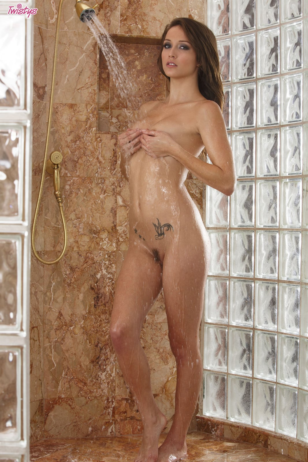 Malena Morgan enjoys a shower and shows her pussy
