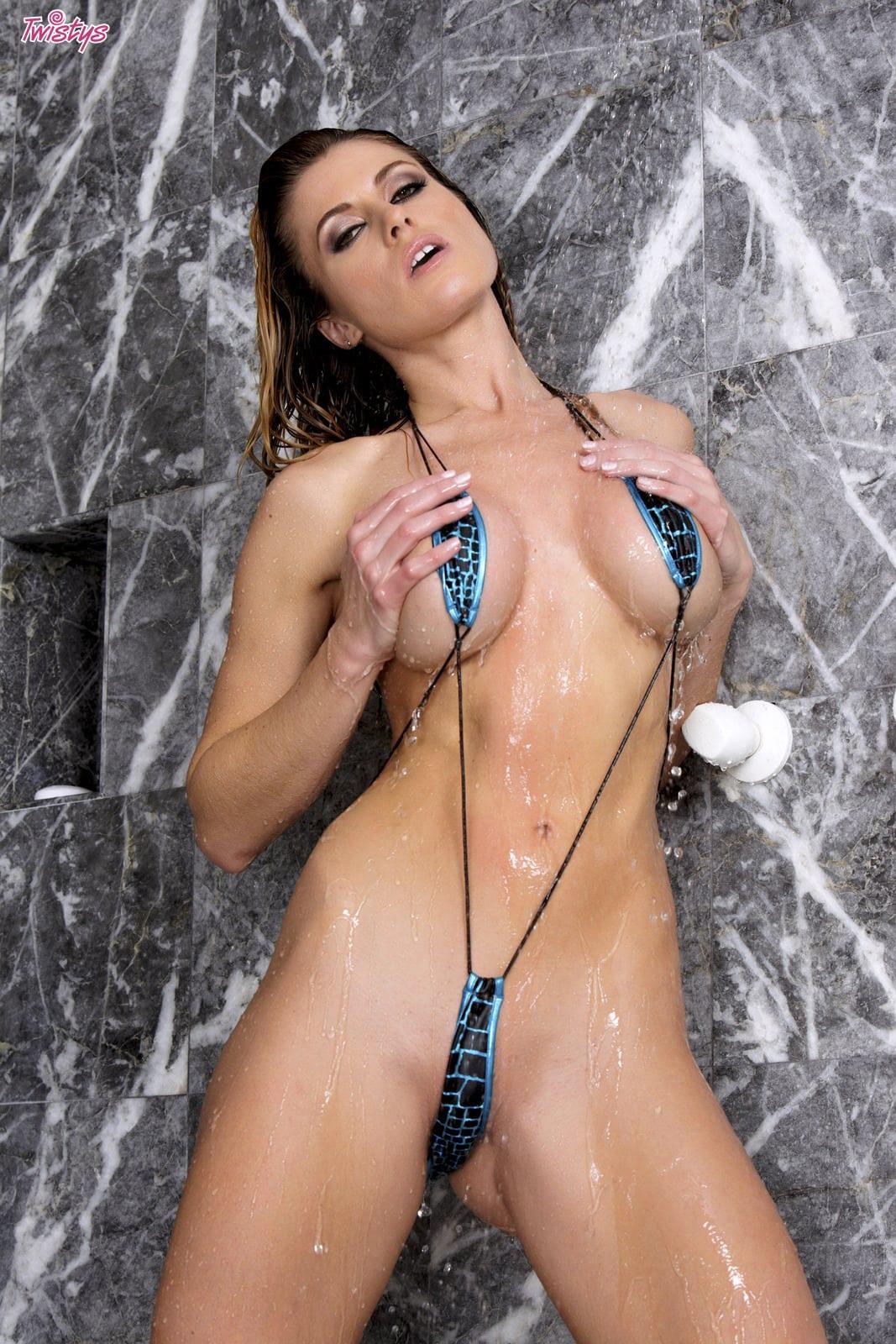 Randy moore takes a shower in her sling bikini photo
