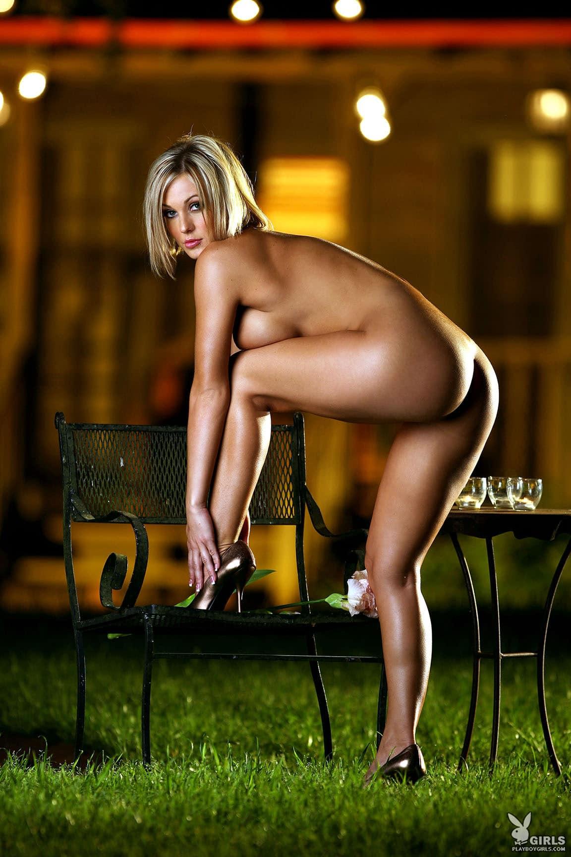 Crystal Stevens posing naked on grass in evening